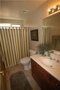 Full hall bath with tub & shower combo & large vanity