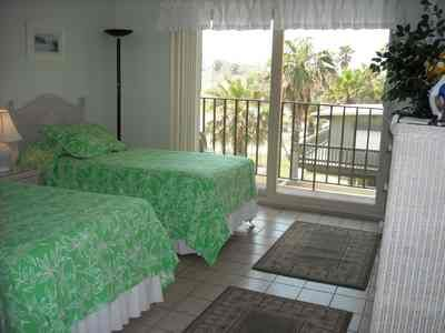 Second bedroom with twins and view of the pool