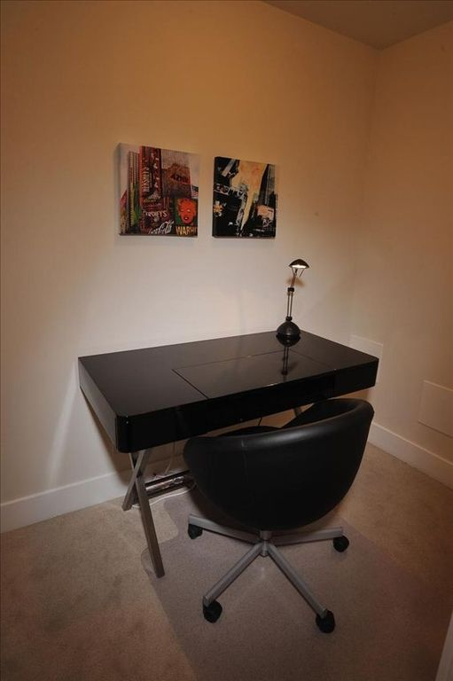 Office with beautiful sleek, glossy black desk