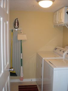 Utility room with full size washer and dryer.