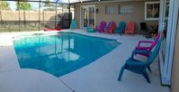 Spacious 4 BR Home w/ Sparkling Pool & Dock on Saltwater Canal!