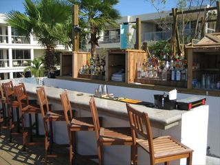 Providenciales - Provo condo photo - Somewhere Cafe - second floor bar overlooks Grace Bay