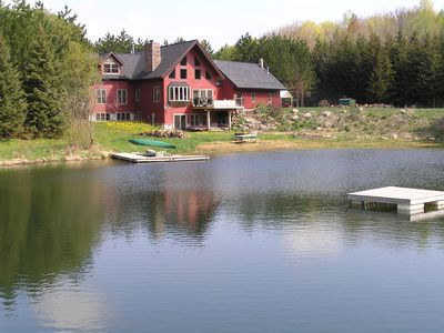 Beautiful custom built home  nestled on 10 acres with swimming pond