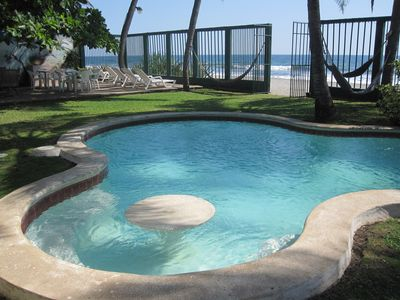 pool with seating and table. great area for fun in the sun & drinks.
