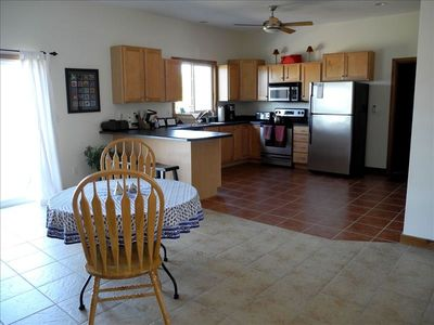 Large, well-equipped kitchen with new appliances and breakfast bar.