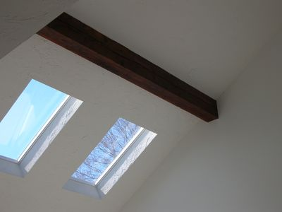 Skylights in the cathedral-style living room.