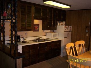 Big Bear Lake cabin photo - Comfortable kithcen/dining area with range fridge micro & more