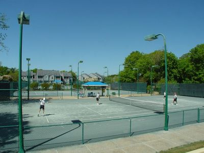 . . . and lighted tennis courts to challenge your skills!*