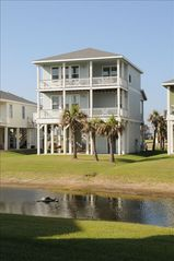 Galveston cottage photo - Two balconies in back and one in the front to enjoy the beach and ocean.