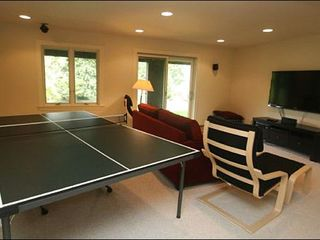 Stowe townhome photo - Ping Pong Table and Large, Flat-Screen TV in the Game Room
