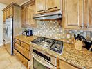 Kitchen - The modern kitchen features high-end stainless steel appliances, like a 5-burner gas range and 2 ovens.