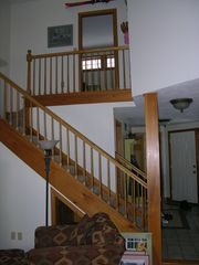 Laconia townhome photo - View of Stairway and Balcony leading to upstairs Bedrooms and full bath