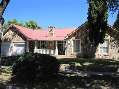 Alpine house rental - Classic stone home with spacious front porch, yard, and 2-car garage