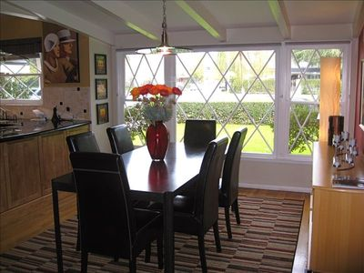 Large dining room with seating for 8