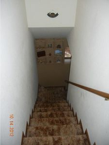 Stairs to HUGE lower bedroom and 1/2 bath