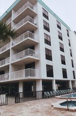 Madeira Beach condo photo - Corner balcony with views of Gulf & pool area
