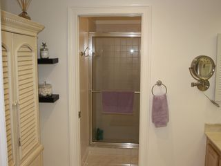 Old Naples house photo - Pamper yourself in the master bath with large shower, twin sinks and high style.