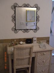 Old Naples house photo - Rattan Makeup Vanity in the Master Bath