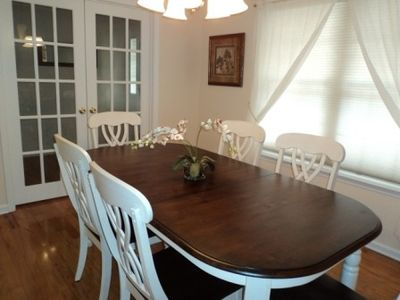 Separate dining room is perfect for a small dinner party or planning sessions