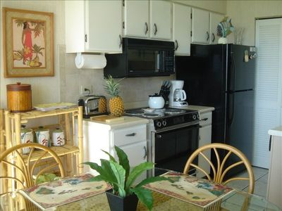 This kitchen has all the conveniences with dish washer & washer/dryer
