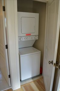stacked washer/dryer in bedroom closet