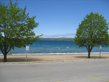 Crystal Lake's warm sandy beaches are fifty feet from your front door