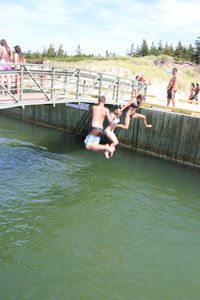 Bridge-jumping at Basin Head Beach (which is rated #1 in Canada!)