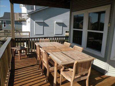 Long teak table seats 8 comfortably for outdoor dining