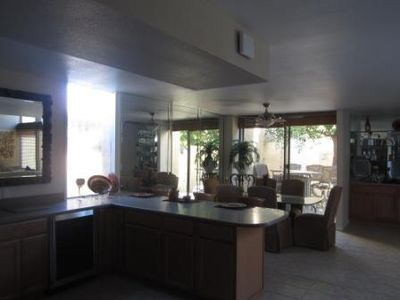 Palm Springs townhome rental - large dining table and patio with bar...
