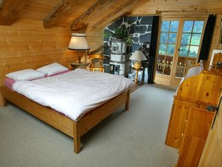 Val-d'Illiez chalet photo - Upper level master bedroom with authentic decoration and superb view