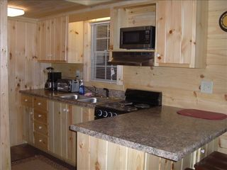 Berkeley Springs cabin photo - Kitchen area includes dishwasher and fridge with i