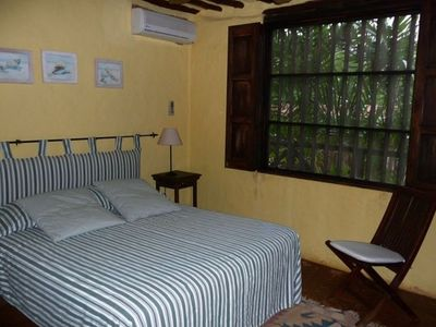 One of three ample queen bed airconditioned bedrooms.