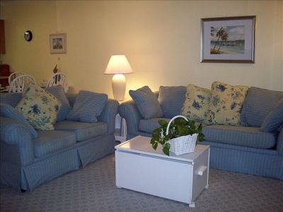 Spacious living area has large, flat screen TV and wet bar
