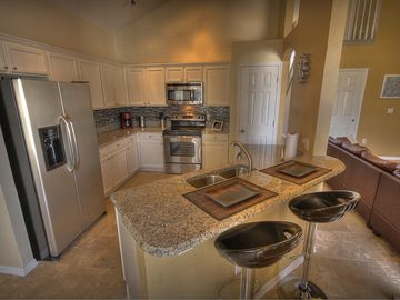 Large gourmet kitchen with granite counters and island, brand new appliances