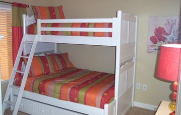Second bedroom has twin over full bunk bed with roll out trundle underneath.