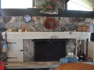 Burt Lake estate photo - Kitchen Fireplace