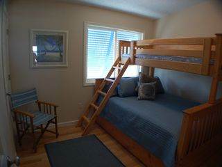 "St. Augustine Beach house photo - ""Sand"" Family Bedroom sleeps 4 in queen bed, twin bunk, trundle!"