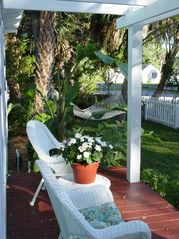 Gulfport cottage photo - Romantic pergola porch. Waterview and watch joggers, walkers etc frm the porch.