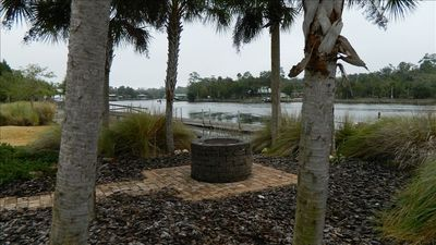 Steinhatchee house rental - Community fire pit between pool and river