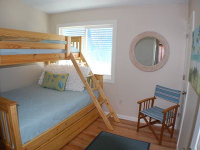"""Surf"" Family bedroom sleeps up to 4 in queen bed, twin bunk and trundle"