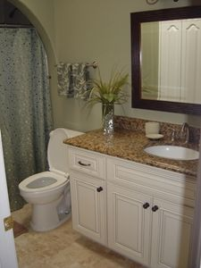 Guest Bath with Granite counters and marble floors