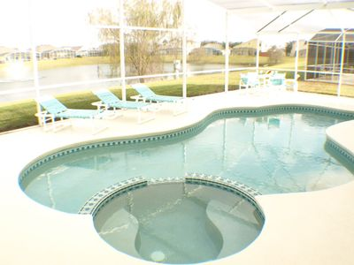 Pool/Jacuzzi Overlooks lake. Extended decking area
