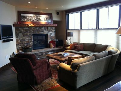 Open living room - large sectional sofa, gas fireplace, flat panel TV