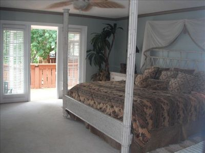 Main Level Master bedroom walks out to deck! Large Jacuzzi tub & many mirrors