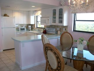 Sanibel Island condo photo - Dining Room and Kitchen See miles down the beach.