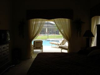 Clermont villa photo - From master bedroom through garden doors into your Florida sunshine.