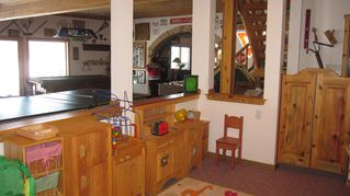 Elkhorn house photo - The half wall has the little ones feeling secure, but not underfoot.
