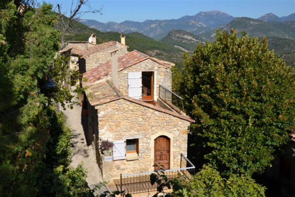 Small house perched on a rocky peak in the Massif des Baronnies