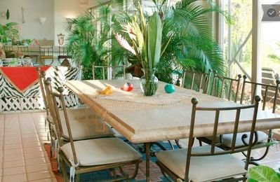 Marble Dining table, seats 10, floor-to-ceiling glass doors open to ocean-view
