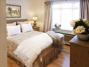 Master bedroom w/ luxury queen bed and en suite bathroom